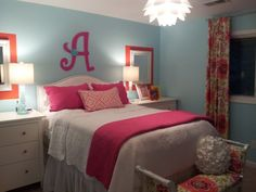 Teen girls bedroom: orange, pink, blue Sources: Dressers- Ikea Mirrors-Home Depot Bedding-Steinmart Pillows & Drapes-Custom