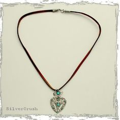 Silver heart pendant with blue opals on a leather by silvercrush, $106.00