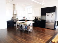 modern two-tone kitchen in chic downtown new york loft. markdavidny.com