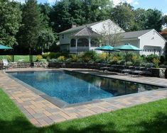 rectangular pool with sloping uphill retaining wall ... on Uphill Backyard Landscaping Ideas id=15669