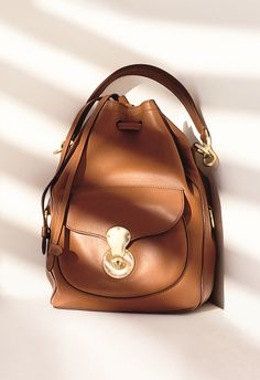 Modern and sophisticated, the Ralph Lauren Ricky Drawstring Bag is crafted  in Italy from ultra 1c00e8d596