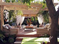 After: Landscape designer Jamie Durie has created a tropical retreat that includes two outdoor rooms, a lounge area and a dining room. Creating a Key-West theme, Durie uses whitewashed timbers, bright hues of aqua and mirrors (to create the illusion of space). Pastel-colored storm-guard shutters, a sunken eco-firepit and tropical palms complete the island vibe.