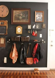 an entryway filled with pictures, shelves, and hooks.