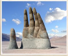 THE HAND OF THE DESERT  Sculpture by: Mario Irarrázabal  Created: 1992 / Chile    Original Image by: Marcos / Wikimedia Commons  Edited and modified by: Curious Britain