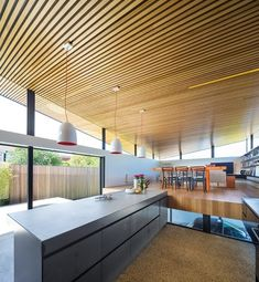 Timber battens striate the underside of the living area's roof plane, pushing out through the clerestory glazing.