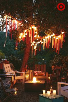 Here's an easy 4th of July party trick: Give classic streamers a cool upgrade by layering different lengths of crepe paper on the branches of a backyard tree. Using two colors (we used red and white) will help keep it simple, and easily blend with strings of paper lanterns. Create a welcoming and cozy seating area with a laid-back mix of indoor and outdoor chairs, and a scattering of poufs and cushions around the fire pit—the perfect gathering spot come dusk.