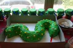 we had a reptile birthday party! The Snake cake was a hit. In the back are mason jars filled with candy!