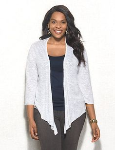 Not your average cardi; this one's got lace-back detail to add the ultimate summer chic pop. Imported.