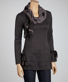 Stylishly structured, a cowl neck and ruffled accents give a great piece a fashionable edge. Quality craftsmanship and classic colors with a fun and funky vibe make this tunic a must-have.Measurements (size S): 28'' long from high point of shoulder to hem65% polyester / 30% cotton / 5% elastaneHand wash; dry flat