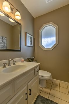 Traditional Powder Room with Powder room, Undermount sink, Touch Snow, Glazed Porcelain., limestone tile floors, Limestone