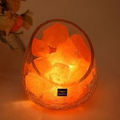 Showcased in eye-catching crackled glass bowls brimming with natural Himalayan salt crystals, these air-purifying lamps bring a soothing, amber glow into your bedroom, home office or nursery. <br>   <ul><li> Natural Himalayan salt removes airborne irritants </li> <li> Introduces negative ions into the environment for improved well-being </li> <li> 10 watt bulb and dimmer included </li> <li> Available in 2 styles to suit any ...