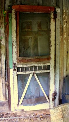 Forgotten Screen Door I so LOVE wooden screen doors.The sound of them slamming shut . Vintage Screen Doors, Old Screen Doors, Wooden Screen Door, Vintage Doors, Old Windows, Windows And Doors, Porch Doors, When One Door Closes, Cool Doors
