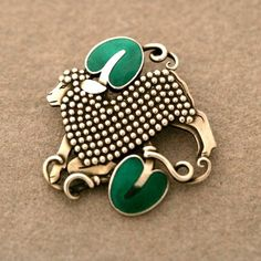 "Brooch | Designed by Arno Malinowski for Georg Jensen. ""Lamb"". Sterling silver with green enamel. ca. 1940s"