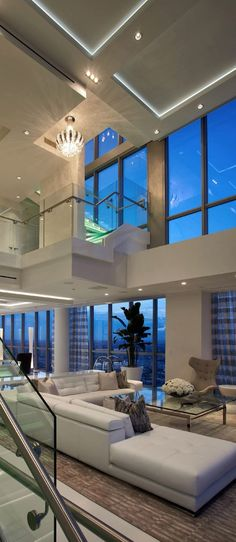 Beautiful shot of this living room with excellent window's and interior's.