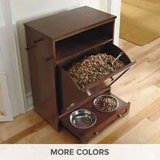 The Pet Feeder Station from Grandin Road is a great way to store your pet's food and hide the bowls when company comes!