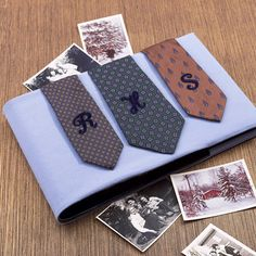 Dressed Up Album    Surprise Dad with a twist on the classic Father's Day gift: the necktie. To make, adhere his initials to three ties with embroidered or fabric letters. Use fabric glue to attach the ties to a photo album covered with soft wool for a new take on the expected necktie gift.
