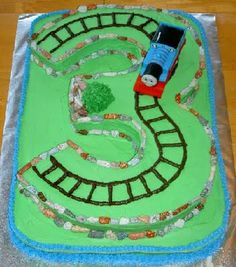 thinking about a train theme for hunter's birthday and this would be so cute!