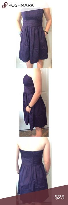 Dark Purple David's Bridal Strapless Dress Super cute dress, good condition. Style 83312. Shell 100% cotton. Lining 100% polyester. Structured chest. Has pockets. 31 inches long. David's Bridal Dresses