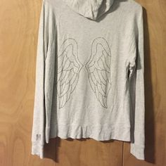 Victoria's Secret Angel Zip Hoodie Comfortable zip hoodie. Only worn a few times still in great condition. No stains, rips, or holes.  Gorgeous Angel wings on back of sweatshirt. Size Large Victoria's Secret Tops Sweatshirts & Hoodies