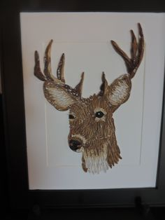 QuillingKimStarcher, quilling wall art .A spectacular quiling of a male deer. It is framed in a 14 x 17 black frame with a white matt.