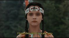 """My fucking favorite movie character: """"Christina Ricci as Wednesday Addams in The Addams Family, and especially in Addams Family Values. This scene is perfection, calling out the racism in the whole American vision of Thanksgiving and appropriation of Native lands, as well as the outcasts of the camp, the freaks, nerds, and of course POC getting their revenge on the yuppies. My grade school hero."""""""