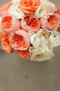 simple coral and white bouquet. (imagine with hints of blue and gray for yours, with a variety of flowers..