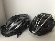 PAIR OF BELL (EXPLORER AND ADRENALINE) BICYCLING HELMETS IN GRAY/BLACK COMBOS. SIZE: ADULT.