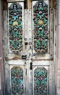 A door in San Miguel, Mexico. I love how the decorations on the weathered wood make the door look naturally colorized.