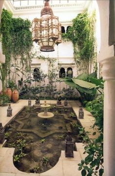I like this because it feels outdoors due to the plants, finishes, and high ceilings but it still remains actually indoors. I like the Moorish elements and the large amount of light. I like that there are plants in the water.