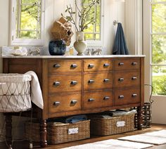 Vintage inspired pharmacy, card catalog, and dental cabinets make great options for storage.