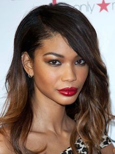 Model Chanel Iman looks like she's on her way to the sexiest of parties. From the metallic shadow to the bold crimson pout, this makeup isn't right for your office shindig...but it sure is perfect for a night on the town.  -Cosmopolitan.com