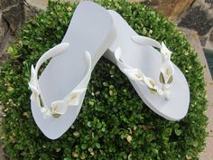 pretty flip flops for the bridsmaid gifts..........White Calla Lily Flip Flops by rocktheflops on Etsy, $33.00