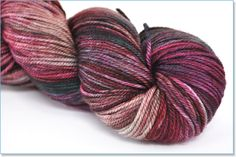 Smooshy with Cashmere  Smooshy with Cashmere is a springy, soft fingering weight yarn. A blend of superwash merino and cashmere, Dream in Color's newest sock yarn is a treat for your feet. One skein makes a pair of average adult women's socks.