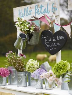 Create a 'best in bloom' floral display for your garden party (The Contemporary Home).