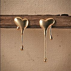 I'll stop the world and melt with you…  Melting Heart Stud Earrings by Yayoi Forest