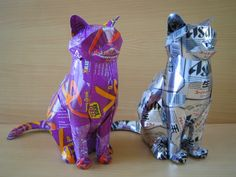 These cats are made from old aluminum containers!