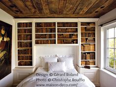 Design © Gérard Roland.   Photo © Christophe Rouffio (Oct 2010) via     www.maison-deco.com Photo #11 - Library/Bedroom in a rural home near Genval Lake in Belgium ... No reason not to add a library wall in the Master BR now! And add some reading lamps on both sides.Yeah! -pfb! ... Copyright law requires that you 1. Credit the artist, 2. List/Link directly to artist's website.
