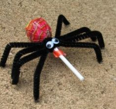 Lollipop, pipe cleaners, googly eyes...spider! :)