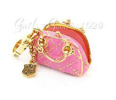 I love purses! I love pink! And I love Juicy Charms. :)