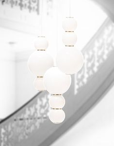 PEARLS Chandelier. Brass, Glass, LED, dimmable. Available in a Version of 3 or 5. Design by Benjamin Hopf.  #Formagenda #Lighting #Design