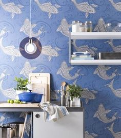 The Derwent koi wallpaper pattern from Osborne & Little enlivens kitchen and bathrooms with different colorways.