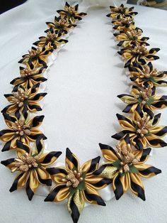 The lei is approximately 36 inches long, open ends. You can adjust the length by tying the ribbon.