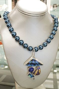 "Journey Collection 19"" necklace with Confetti Glass pendant (detail above) is 12mm midnight blue glass pearls with sterling spacers. Pendant can be removed from necklace.  Please inquire for price and availability."