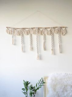 Macrame wall hanging with natural cotton rope on a reclaimed
