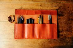 This is a lovely supple Italian leather artist roll, which is very useful for all your many pencils, brushes and tools. This is hand burnished to protect the edges of the leather and a layer of beeswax is applied to the surface to help keep it protected. This is hand stitched with strong Ritza tiger thread. The leather has natural marks and scars, giving it a lovely patina. If there are any repairs in the future let me know and I will happily do them for you. If youre looking for a bespoke…