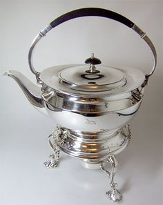 A plain and elegant Art & Craft design silver kettle on a stand, London 1914. Offered by AMS Antiques at Grays.