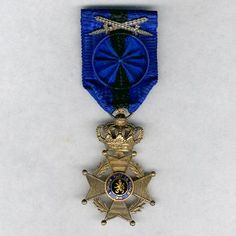 Order of Leopold II Officer's breast badge; Type 2, 1908-1951 unilingual (French); with crossed swords.