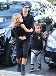 Who needs the gym? Kourtney Kardashian worked her arms by carrying three-year-old daughter Penelope in Los Angeles on Saturday