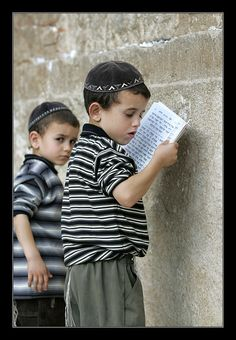 Jerusalem...Look at that expression of distrust on the boy behind the front one. Wonder what he s thinking.