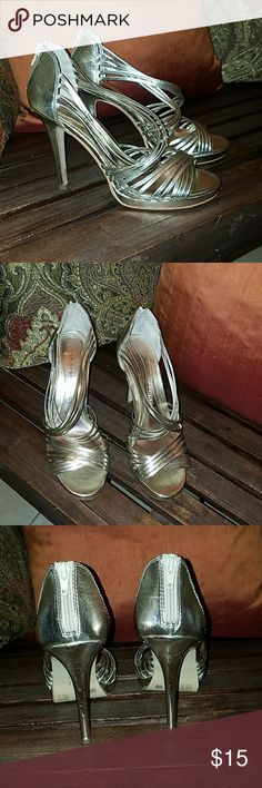 Metallic Strappy Heels These heels are in Great condition. See pictures for wear. There is a mark on the inner heel. The fourth picture shows a zoomed in pic of the mark. Doesn't come with a shoe box. Offers are welcome! Chinese Laundry Shoes Heels